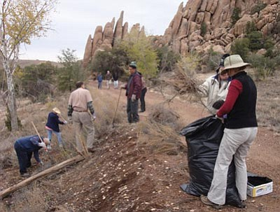 Courtesy photo<br> Volunteers with the Sierra Club turned out recently to help remove invasive Russian knapweed from along the Peavine Trail, near the Point of Rocks.