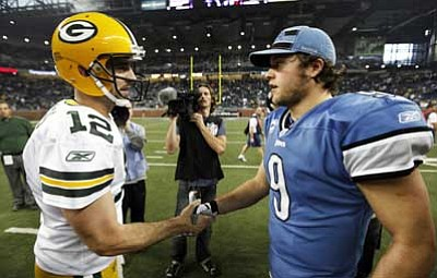 Paul Sancya/The Associated Press<br> Green Bay Packers quarterback Aaron Rodgers (12) and Detroit Lions quarterback Matthew Stafford (9) shake hands after their NFL football game in Detroit on Thursday. Green Bay won 27-15.
