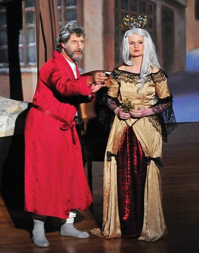 """Les Stukenberg/The Daily Courier<br>Brad Newman as Ebenezer Scrooge and Alysia Kukyno as the Spirit of Christmas Past perform a scene from """"A Christmas Carol,"""" which opens at the Elks Opera House beginning Dec. 1."""
