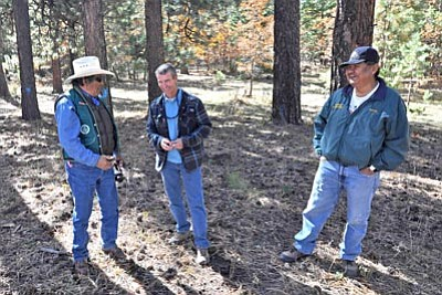 Courtesy Kaibab National Forest<br> Nelson Roanhorse (left), a Bureau of Indian Affairs timber management officer, and Robert Billie (right), a Navajo Nation forester, share a laugh with Garry Domis, a Kaibab National Forest silviculturist.