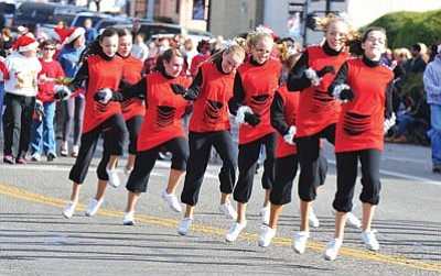 Les Stukenberg/The Daily Courier<br /><br /><!-- 1upcrlf2 -->Yavapai County 4H cloggers dance during last year's Christmas Parade in downtown Prescott.