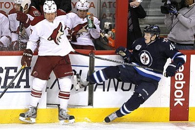 AP Photo/The Canadian Press, John Woods<br /><br /><!-- 1upcrlf2 -->Phoenix Coyotes forward Raffi Torres (37) checks Winnipeg Jets forward Carl Klingberg (48) during the first period of an NHL hockey game in Winnipeg, Manitoba, on Thursday.