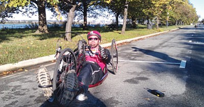 Courtesy photo<br>Retired U.S. Marine Corps Sgt. Michael Blair, an Embry-Riddle Aeronautical University student, rode as part of Team Semper Fi during the Marine Corps Marathon in Washington, D.C.