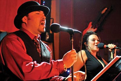 Matt Hinshaw/The Daily Courier/file<br>Marco Espitia and Mallory Desjadon perform during the 2010 Acker Musical Showcase at Matt's Saloon in downtown Prescott.
