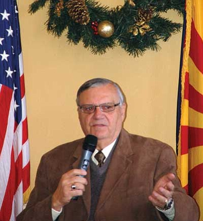 Joanna Dodder/The Daily Courier<br> Maricopa County Sheriff Joe Arpaio speaks at the Yavapai County Republican Men's Forum Christmas luncheon on Monday.