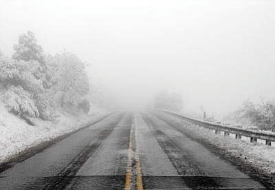 Scott Orr/The Daily Courier<br>Senator Highway was a road to the clouds Tuesday morning, with low visibility as the clouds descended and the snow fell.