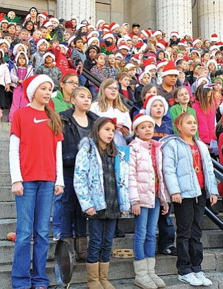 Matt Hinshaw/The Daily Courier<br> Lincoln Elementary School students sing Christmas carols on the courthouse steps Thursday afternoon in downtown Prescott.