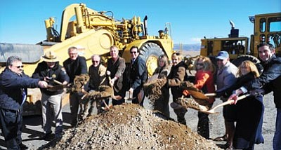 Les Stukenberg/The Daily Courier<br> Officials throw the ceremonial first shovelfuls of dirt at the Highway 89A Spur (Fain Road) groundbreaking on Friday in Prescott Valley. A two-lane northbound roadway parallel to the current Fain Road will be built to create a four-lane divided highway between Highway 69 and Highway 89A.