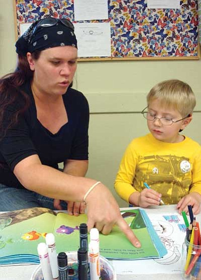 Claire Louge, First Things First/Courtesy photo<br> Kira Turner reads to her son Dominic, 4, who attends preschool at Discovery Gardens in Prescott.