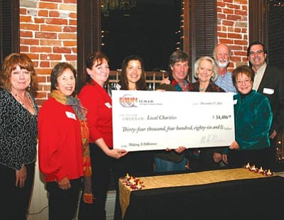 Courtesy photo<br> The Fann Employees Making A Difference program raised nearly $34,500 to give to seven local charities this year, and has generated $226,000 in donations in the six years since its inception.