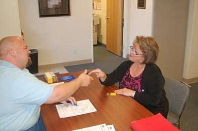 Ken Hedler/The Daily Courier<br>Fred Ingersoll, Human Resources Manager for Team Fishel's Chandler branch, meets with applicant Bonnie Pennington during a job fair Wednesday in the Northern Arizona Council of Governments Yavapai Workforce Connection office in Prescott.
