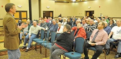 Matt Hinshaw/The Daily Courier<br> Congressman Paul Gosar answers questions from members of the audience Thursday night during a town hall meeting at the Prescott Resort.