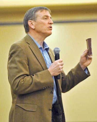 Matt Hinshaw/The Daily Courier<br> Congressman Paul Gosar talks with members of the public while holding up a pocket copy of the U.S. Constitution Thursday night at the Prescott Resort during a town hall meeting.