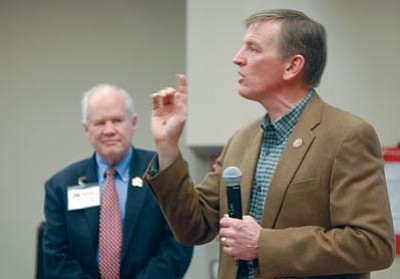 Joanna Dodder/The Daily Courier<br> U.S. Rep. Paul Gosar talks to Yavapai County Republican Party members Saturday about his decision to move to Prescott's congressional district, while Yavapai County Republican Party Chair Mal Barrett Jr. looks on.
