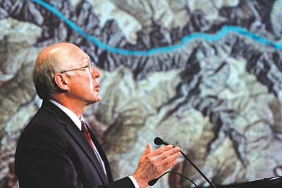 Jacquelyn Martin/The Associated Press<br>Interior Secretary Ken Salazar, standing in front of a projected map of the Grand Canyon, announces a 20-year ban on new mining claims near the Grand Canyon on Monday in Washington.