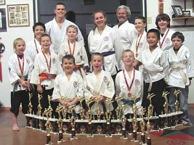 Courtesy Photo<br /><br /><!-- 1upcrlf2 -->Pictured from left to right<br /><br /><!-- 1upcrlf2 -->Back row:<br /><br /><!-- 1upcrlf2 -->Ceiley Plucinsky-Kumite 1st-Kobudo 1st, Andrew Rojas- Kata 4th- Kumite 1st , Shihan Alex- Kata 3rd- Kumite 1st- Kobudo 1st , Mackenzie Donovan- Kata 2nd- Kumite 1st, Kyoshi Gary, William Muller- Kata 2nd- Kumite 5th, Danielle Hamilton- Kumite 1st,  ,Keenan Morris-Honorable Mention<br /><br /><!-- 1upcrlf2 -->Front/center row<br /><br /><!-- 1upcrlf2 -->Silas Snyder- Kata 3rd- Kumite 4th, Brendan Penney Kata 4th- Kumite 3rd, Dylan Donovan- Kata 1st- Kumite 1st, Trey Snyder- Kata 3rd- Kumite 3rd- Kobudo 3rd, Fisher Plucinsky- Kata 1st, Memphis James- Kata 3rd- Kumite 1st.