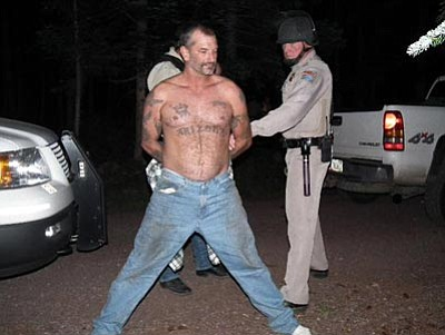 The Associated Press<br>U.S. Marshals take John McCluskey into custody Aug. 19, 2010, at an eastern Arizona campground on the Apache-Sitgreaves National Forest.