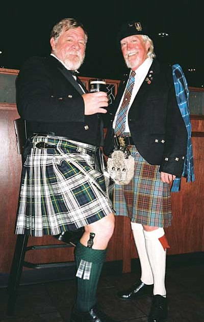 Courtesy photo<br> Larry Lamper, left, and Bob Anderson sport their Scottish kilts at a Robert Burns supper honoring the famous poet at Celtic Crossings Pub.