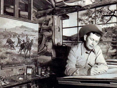 Photo courtesy of the Phippen Museum <br> George Phippen works in his studio in this 1950s photo.
