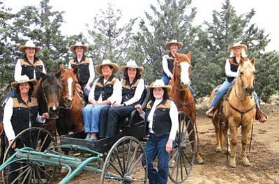 Deniece McAnulty, Granite Mountain Riders/Courtesy photo<br> Back row on horseback, from left to right, are Deniece McAnulty, president; Susan Sestak, secretary; Barbara Caserman, treasurer; and Debbe Dolson, vice president.  Front row, from left to right: Danielle Feller, winner of the Work Horse of the Year Award, Gayle Higgs and Memory Wolfe winners of 30 Year Granite Mountain Service Awards; and Toni Connolly, winner of the Top Hand Award.