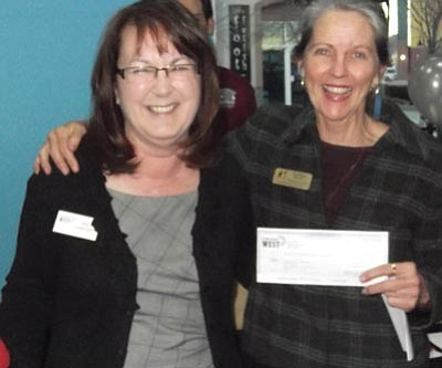 Courtesy<br>Janet Humphrey, Credit Union West's community education specialist, presents the firm's Bowl for Kids Sake sponsorship check to Kathleen Murphy, YBBBS president and CEO.