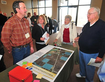 Les Stukenberg/The Daily Courier<br>ADOT Assistant District Engineer Robert LaJeunesse and ADOT Project Manager Charla Glendening answer questions from Marilyn and Dale Benefiel at a meeting for the discussion of a proposed realignment of Willow Creek Road Wednesday night in Prescott.