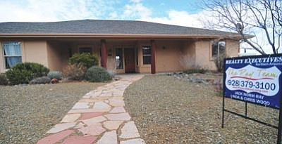 Les Stukenberg/The Daily Courier<br>Kathi Dollarhide is close to short-selling her Yavapai Hills home. Dollarhide is hoping to avoid watching the house slip into foreclosure.