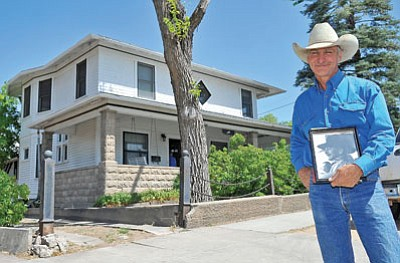 Gail Steiger, son of former Arizona Congressman Sam Steiger and grandson of Gail Gardner stands in front of the Gardner Family Home on Mt. Vernon while holding a photo of Gail Wednesday afternoon in Prescott.<br> Matt Hinshaw/The Daily Courier