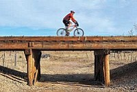 Matt Hinshaw/The Daily Courier<br> Gary Flannery, 70, rides his mountain bike down the Peavine Trail in Prescott.  Flannery completed a 2,476-mile bike ride from Prescott to south Florida from October 24 - November 20, 2009.