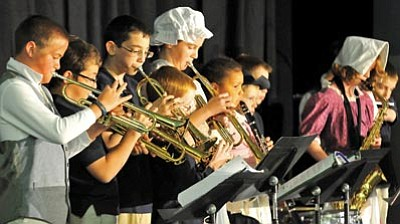 Matt Hinshaw/The Daily Courier<br /><br /><!-- 1upcrlf2 -->Members of the Trinity Christian School band play patriotic songs for the crowd Thursday morning.<br /><br /><!-- 1upcrlf2 -->
