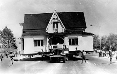 Photo courtesy of Ken Kimsey<br>The Bashford House begins its journey six blocks down Gurley Street to the museum grounds on April 19, 1974. It was removed from the corner lot just to the right in this photo (where Jack in the Box is now located).