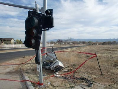 "Prescott Valley Police Department/Courtesy<br> A control box at Windsong and Lakeshore drives took the brunt of the damage when a Chrysler 300 ""traveling at a high rate of speed"" left the roadway and crashed into it early Sunday morning."