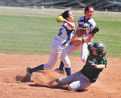 Les Stukenberg/The Daily Courier<br /><br /><!-- 1upcrlf2 -->Yavapai's Alexis Lawton breaks up a double play attempt by Odessa's Beatriz Caporal as the Roughriders took on the Odessa College Wranglers Wednesday in Prescott.