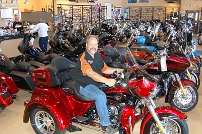 Jason Soifer/The Daily Courier<br>Kyle Rose, co-owner of Grand Canyon Harley-Davidson, poses on a motorcycle at his Mayer dealership Thursday.