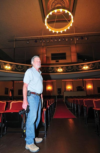 Les Stukenberg/The Daily Courier<br /><br /><!-- 1upcrlf2 -->Former Elks manager Ron Swartz checks out the chandelier at the Elks Opera House Monday.
