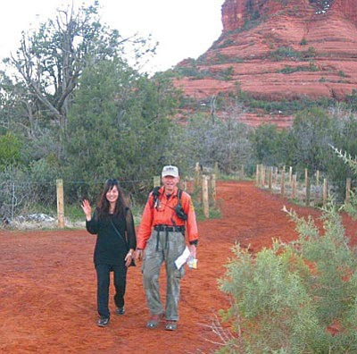 YCSO/Courtesy photo<br> Christine Pae, 38, of Ohio is escorted back to the trailhead by a member of the Verde Search and Rescue Team who found her after she became stranded on Bell Rock in Sedona.