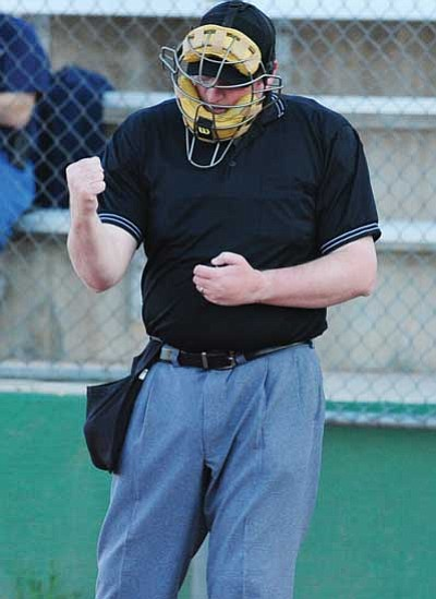 Les Stukenberg/The Daily Courier<br /><br /><!-- 1upcrlf2 -->Daily Courier sports reporter Doug Cook makes a called third strike as he umpires behind the plate during the first games of Prescott Little League's 2012 season Tuesday night.