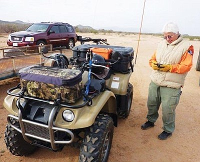 Courtesy photo<br>SYCSRT member Mary DeGeoso gears up for a search mission on her ATV.
