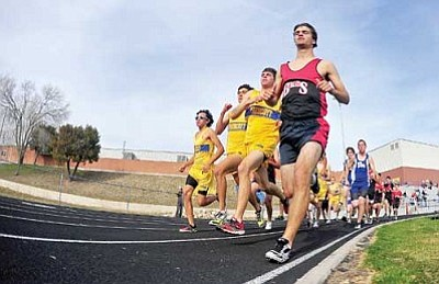 Matt Hinshaw/The Daily Courier<br /><br /><!-- 1upcrlf2 -->Bradshaw's Ryan Madler and Prescott's Hayden Palmer lead the pack through their first turn during the 1600-meter run April 4 at the Prescott High School track meet.