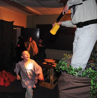 "Les Stukenberg/The Daily Courier<br> The Living History Holocaust Museum at Bradshaw Mountain Middle School simulates the attempted escape of a concentration camp prisoner; work camps in which students must move foam bricks; and the ""tattooing"" of identification numbers."
