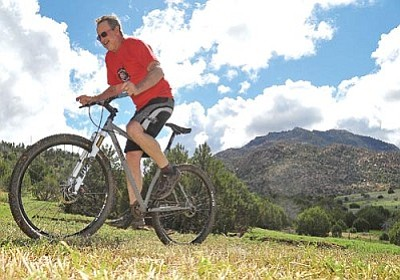 Matt Hinshaw/The Daily Courier<br /><br /><!-- 1upcrlf2 -->Chris Carothers gets a quick practice ride in near his home in Williamson Valley Thursday afternoon. Carothers will be riding in the Whiskey Off-Road amateur class this year.