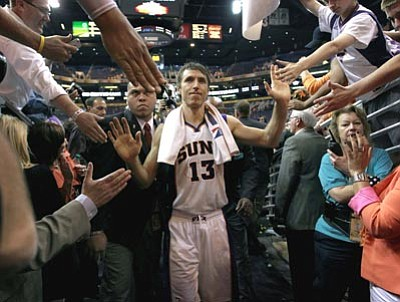 Phoenix Suns' Steve Nash leaves the court after an NBA basketball game against the San Antonio Spurs, Wednesday, April 25, 2012, in Phoenix. This could be Nash's final game for the Suns. The two-time MVP and eight-time All-Star will become a free agent this summer and is seeking a three-year deal. (AP Photo/Matt York)