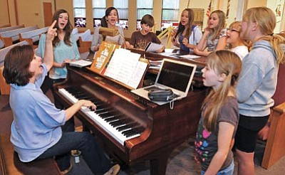 """Matt Hinshaw/The Daily Courier<br>Debbie Place, music director, works with members of the Park Avenue Theatre on the song """"Day by Day"""" from the musical Godspell Tuesday evening at the Trinity Presbyterian Church during rehearsal for the Monica Kaplan benefit concert."""