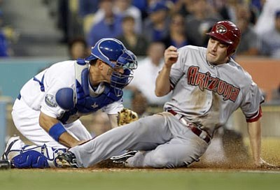 Reed Saxon/The Associated Press<br> Arizona Diamondbacks' A.J. Pollack is tagged out by Los Angeles Dodgers catcher A.J. Ellis, trying to score from second on a Willie Bloomquist double in the third inning of a National League baseball game Monday in Los Angeles.