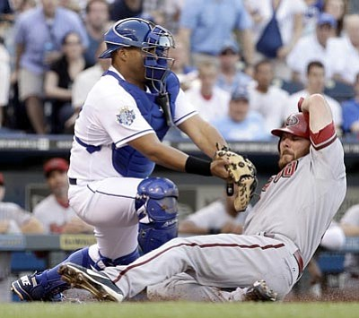 Kansas City Royals catcher Brayan Pena tags out Arizona Diamondbacks' Jason Kubel during the second inning of a baseball game Saturday, May 19, 2012, in Kansas City, Mo. (AP Photo/Charlie Riedel)