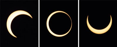 Eranga Jayawardena/AP, file<br> The various stages of an annular solar eclipse are seen over Anuradhapura,  Sri Lanka, Jan. 15, 2010, in this composite photo.
