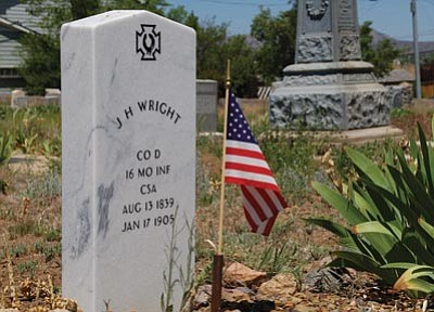 Lisa Irish/The Daily Courier<br /><br /><!-- 1upcrlf2 -->Yavapai Cemetery Association volunteers recently cleaned graves, including this veteran's, at Citizens Cemetery in Prescott in preparation for the upcoming Monday, May 28, ceremony.