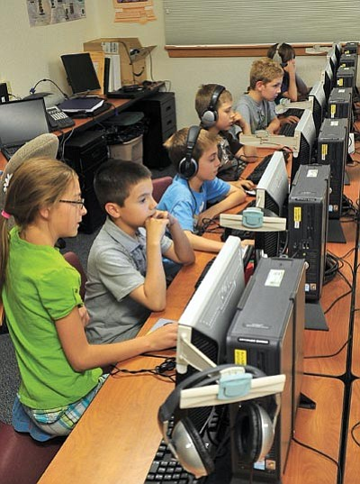 Matt Hinshaw/The Daily Courier<br> Students in the Abia Judd Elementary School Centennial Cinema Club edit and compile their Centennial Celebration DVD.