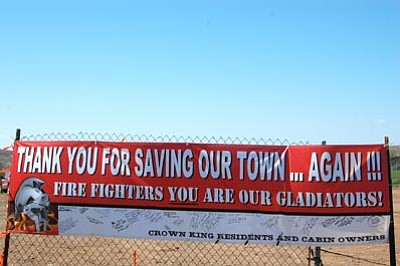 Joanna Dodder/The Daily Courier<br> Crown King residents erected this thank-you sign at the entrance to the Gladiator firefighting headquarters at Mayer High School.