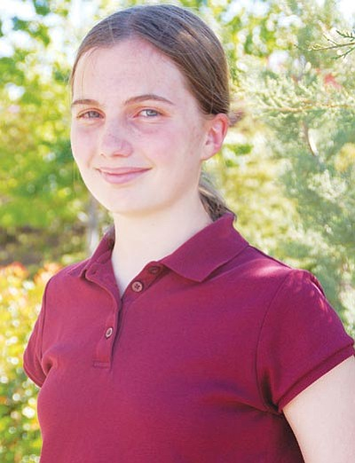 Lisa Irish/The Daily Courier<br> K'Tera Bartels, 14, is valedictorian of Trinity Christian School's 2012 graduating class and its youngest graduate.